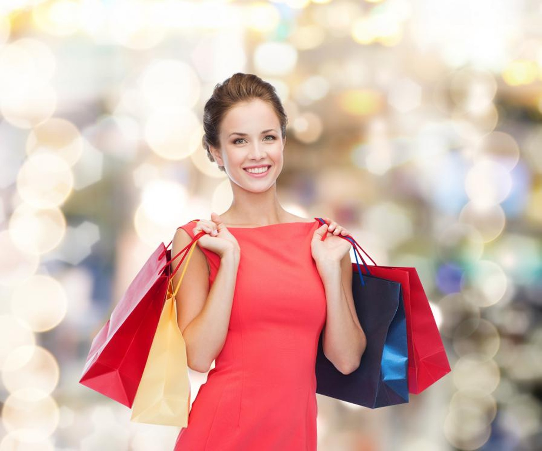 smiling-elegant-woman-in-dress-with-shopping-bags