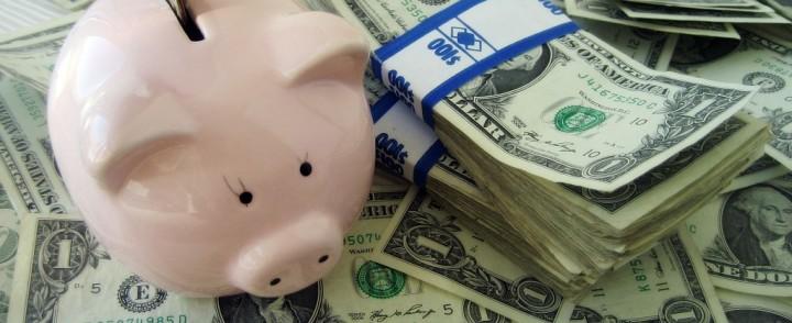 money into piggy bank